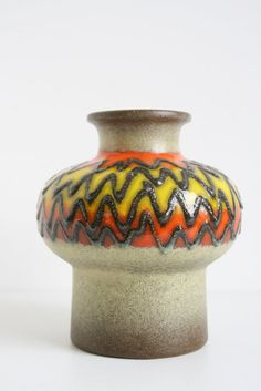 A VEB Haldensleben vase, glazed yellow and orange on a green background with thick lava stripes.  marked: 3093 height: ca16,5 cm. weight ca. 668 grams.   Please inquire for multiple purchases!  https://www.etsy.com/nl/shop/vintagemoodsNL