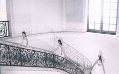 Models walk the stairs to join the finale of Christian Dior Haute Couture Fall/Winter 2012
