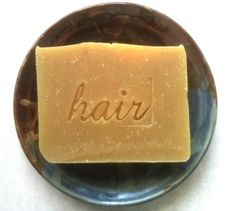 This is a 100% vegan shampoo bar made with a blend of base oils including Organic Extra Virgin olive, Organic Coconut oil, unrefined Shea Butter, Castor oil, and Organic Jojoba. The bar is scented with Lavender essential oil and Benzoin botanical resin, which has a sweet Vanilla-like