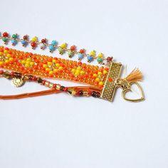 Nouveau ! Bracelet multirangs orange avec sequins et pompons #chamane #chamanebijoux #petitprix #bijoux #bijouxfaitsmain #ideecadeau #faitmain #bijouxfantaisie #boho #boheme #bohemechic #chic #ethnique #ethnic #hippie #handmade #madeinfrance #bohochic #bohostyle #beadsart #beadsjewelry #creoles #pompons #tissagedeperles #perlestissees