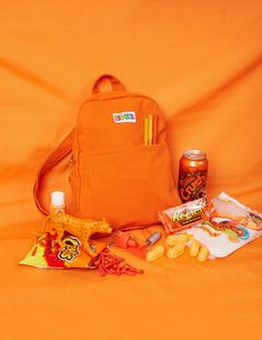 Your new go-to bag! Beautifulcustom dyed Orangedenim withgold trim zipper and Big Bud charm. Floppy and flexible. Leave your purse at home and take your new