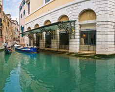 Present day facade of the water entrance of La Fenice, featured in chapters 10, 11 & 12.