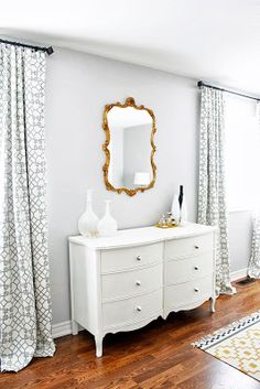 white dresser/brass mirror/grey walls: should consider knobs and mirror together - don't have to match - but should not fight each other each