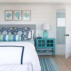 Turquoise Bedroom with Grey Headboard, White Bedding and Striped Blue Rug | Whitten Architects