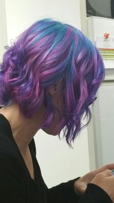 Galaxy hair! Wild orchid pravana, magenta, teal, blue and purple! Short sassy bob hair style with textured beachy wavea