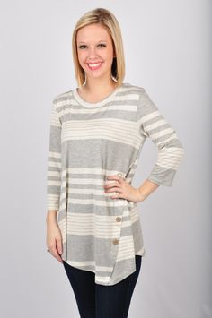 It's all Bars and Stripes with our Bars and Stripes Top! Pair with your favorite pair of leggings and booties and you're all set! This top also features a button detail down the side. The top is also quarter sleeved and featured in heather grey and white! This top is made out of 95% Rayon and 5% Spandex. www.VirgoBoutique.com