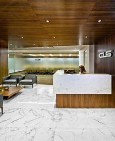 CLS NYC HQ Designed by M Moser Associates - a sea of walnut and marble. #workdifferent