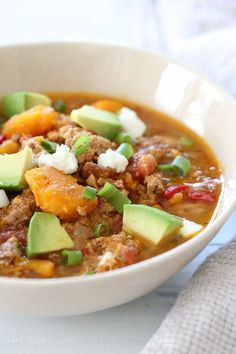 Fall, football games, and chili season is JUST around the corner. Here's a delicious, hearty, bean-less chili recipe made in the slow cooker with ground chicken, ground beef and sweet potatoes – the perfect combination from Juli Bauer's Paleo Cookbook.    This might be the easiest slow cooker chili recipe I've ever made because it's very little prep! Just throw all the ingredients into the slow cooker – no need to brown the ground meat or any of the other ingredients first. After the meat…