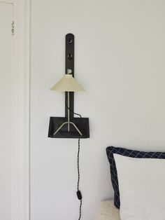 Spotted in a bedroom in Bellport, New York, by designer C. Valentin: a Shaker-style sconce that Valentin spray-painted with glossy black paint. Photograph by Jonathan Hökklo for Remodelista. Outdoor Light Fixtures, Outdoor Lighting, Exterior Lighting, Colonial House Remodel, Wall Sconce Lighting, Sconces, New York Projects, Task Lamps, Shaker Style