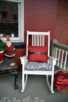 50 Stunning Christmas Porch Ideas - #ChristmasDecorating - I think my favorite part is the red pillow with the belt on it. I would never have thought of that. #ChristmasPorch