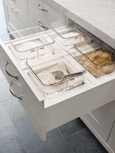A drawer with custom inserts for dry-goods storage. From Maison & Demeure.