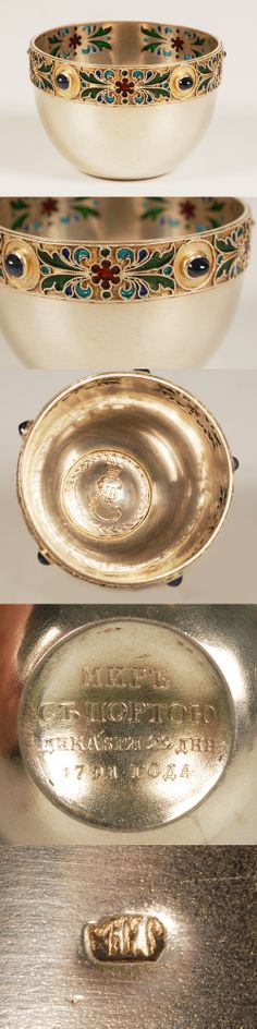 """A Russian silver gilt, gemstone and plique-a-jour enamel salt, maker's mark """"HA"""", Moscow, circa late 19th century. Of circulr form, the salt decorated with a band of scrolling foliate motis in translucent shades of red, green and blie plique-a-jour. Set with five blue gemstones, the bottom with coin."""