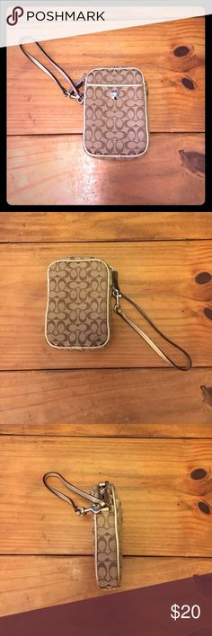 Tan/Gold Coach Wristlet Tan Coach Wristlet with light brown small C logo and gold trim/strap. Could also be used as a phone case, camera case, etc. has small front pouch along with regular zipper pouch. Perfect condition! Coach Bags Clutches & Wristlets