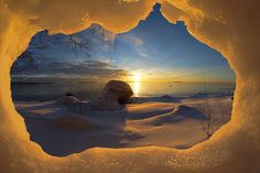 Wow! Amazing sunrise view from a snow cave in Finland.