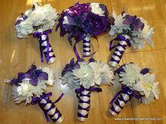 Ivory satin handles with regency purple crisscross ribbon. Tear shape brides bouquet in Regency purple and Ivory at www.silkweddingflowersforless.com
