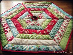 Jelly roll quilted tree skirt. Quick and easy for my little tree that does not have a skirt yet.