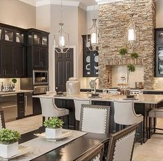 Love the stones for fireplace idea and then the black cabinets for kitchen....