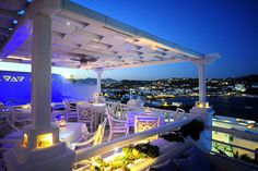 Night at La Meduse gourmet restaurant at the Kivotos Mykonos Luxury Hotel with a view of Ornos Bay
