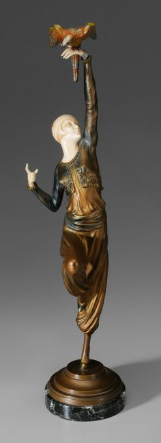 "Paul Philippe - Lot 202 for July 2012 Auction.  (French, 1870-1930) Turkish Dancer With Parrot, signed on base with cipher and ""P. Philippe"", cold-painted, parcel gilt bronze, ivory, 19-5/8 in.    Estimate $4,000 to $6,000."