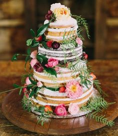 Naked wedding cake inspiration with flowers,greenery and strawberries ,wedding cakes