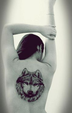 "Yamile A (Chubut, Argentina)  ""My second tattoo, a wolf representing the clan, and union protection of my family. No matter what fate might bring, this wolf will always remind me who I am and where I come from."""