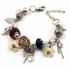 Stunning Charm Bracelet (Silver Tone) Avalaya. $18.99. Theme: leaf. Material: glass. Type: bead jewellery. Occasion: anniversary, casual wear, office wear. Metal Finish: rhodium plated