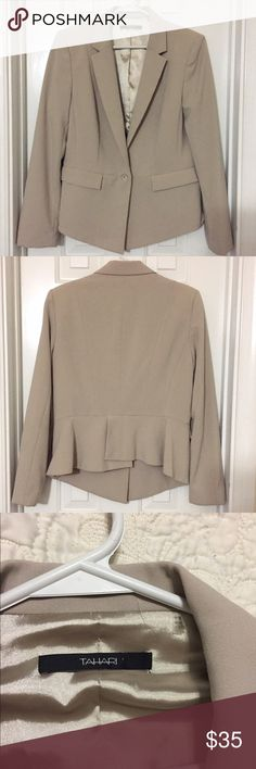 NEW Tahari 🌸 Blazer Suit Jacket MAKE AN OFFER! Selling this gorgeous Blazer for a friend of mine. It's never been worn or washed. The two pockets in the front are still sewn shut. The back slight ruffle is adorable! I wish this fit me. Size: US 12 & UK 16. Fully lined. One button. Cream off white color. Be polished and professional in this beauty! Tahari Jackets & Coats Blazers