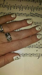 Musical fingers! How to transfer sheet music to your nails with rubbing alcohol!  Read the demo and seems incredibly easy. Printing stuff to transfer now....