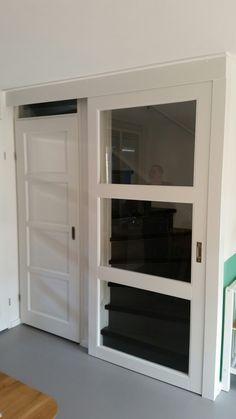 Schuifdeur voor trap bestaande deur gehouden