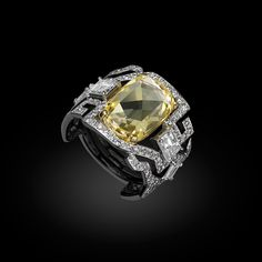 Carnet Fancy Diamond Delight ring with fancy intense yellow and white diamonds set in platinum and 18k yellow gold