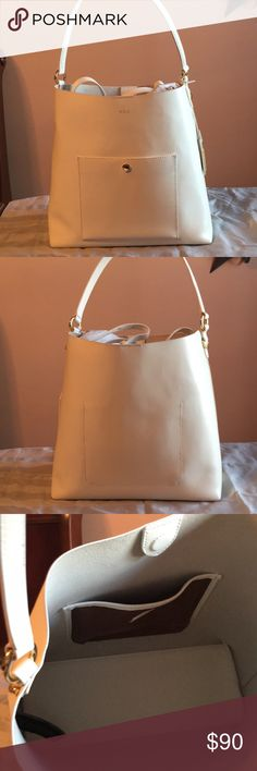 Lauren Ralph Lauren Hobo purse Pretty spacious Hobo purse. Used only once. Just sits in closet. Does have a small black mark on the bottom and small scrape in the leather on the front pocket that isn't noticeable when closed. Comes with a shoulder strap. Lauren Ralph Lauren Bags Hobos