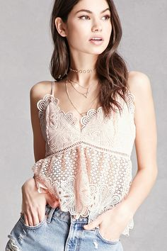A semi-sheer crochet knit babydoll cami featuring scalloped trim, ladder cutouts along the waist, a V-neckline, adjustable straps, a concealed side zipper, and a V-cut back. This is an independent brand and not a Forever 21 branded item