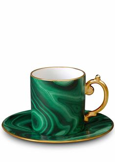 The Fashionable Foodie Gift Guide:  We may take our coffee black but this beautiful green cup and saucer make us want to get our caffeine fix with a dose of color.  L'Objet espresso cup and saucer, $84, saksfifthavenue.com.