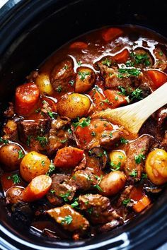 Slow Cooker Beef Bourguignon - crazy tender melt in your mouth beef and hearty veggies slow cooked to perfection in a rich sauce.