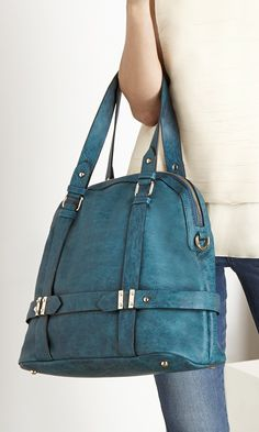 Roomy teal bowler bag with detailed hardware