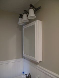 Bathroom Makeovers On A Budget Pull Chain Light Fixture Medicine Cabinets And Bulb