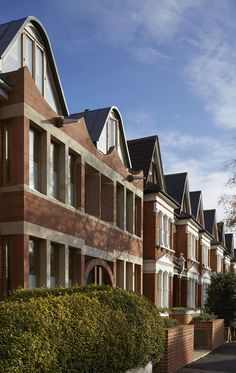 A pair of new houses in Dulwich; London Brownstones replace an ugly 1950's bomb damage infill building and are a contemporary reinterpretation of the Edwardi...