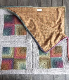 Mitred square knit blanket, lined with fabric and knit-on i-cord