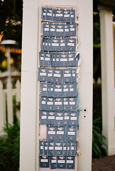 Brides: Paper & Cloth DIY Escort Cards. Simple paper escort cards get a big upgrade with the addition of a scalloped fabric back.