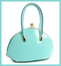Stunning, turquoise jewel top shell frame, quilted satchel with gold tone trim. ~ Snap closure with diamond stone ~ Metal frame - shell shape ~ Patent faux leather ~ Fully lined interior ~ Rear zipper