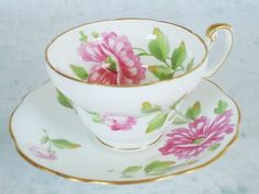 Vintage EB Foley, fine bone china made in England teacup and saucer set in a gorgeous Wedding White with Hot Pink Roses. This cup is hallmarked and signed by A. Taylor, a highly collectible signature