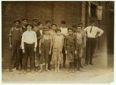 Group of doffers in Pell City Cotton Mill posed by the Overseer. Superintendent of mill is also Mayor of Pell City. Location: Pell City, Alabama 1910 Lewis Hine photo