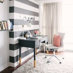 A bold striped wall in a girly office!