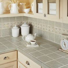 Kitchen Backsplash Ideas: tile countertop gives the look of granite for much less!
