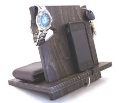 Still looking for the perfect gift for your guy?  This universal cell phone docking station not only looks great, but it's also practical and will help organize all of his everyday items!