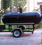 Real Grill's Submarine BBQ Grill | No, that's not a submarine - that's Real Grill's TRG 500 BBQ grill!  This custom made oh-so-shiny grill boasts 46 square feet of cooking area with 3 available fuel sources (gas, wood, and coal), diamond plated doors, and ... a fire extinguisher!