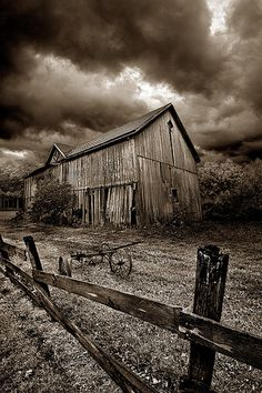 Storm clouds and an old barn -- Reminds me of The Wizard of Oz!