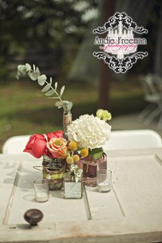 Hydrangea and coral rose centerpiece in burlap wrapped vase with brooch.  Yellow billyballs in vintage vase. On top of vintage door tabletop.  Summer shabby chic barn wedding. Photography by Andie Freeman Photography www.TheAthensWeddingPhotographer.com Event design, floral, and planning by Wildflower Event Services www.WildflowerEventServices.com Venue:  Private property in Chickamauga, Ga Barn Wedding Inspiration, Wedding Ideas, Rose Centerpieces, Private Property, Event Services, Vintage Vases, Event Design, Hydrangea, Wedding Details