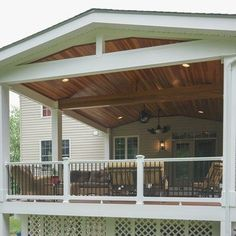The entire deck is covered with a roof structure to protect it from the weather . The entire deck Screened In Porch Diy, Screened Porch Decorating, Screened Porch Designs, Deck Decorating, Pergola Designs, Pergola Ideas, Pergola Kits, Deck Overhang Ideas, Front Porch