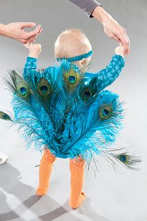 How cute would it be to dress a tiny flower girl like a peacock? Very unique! Peacock costume by Creatively Christy